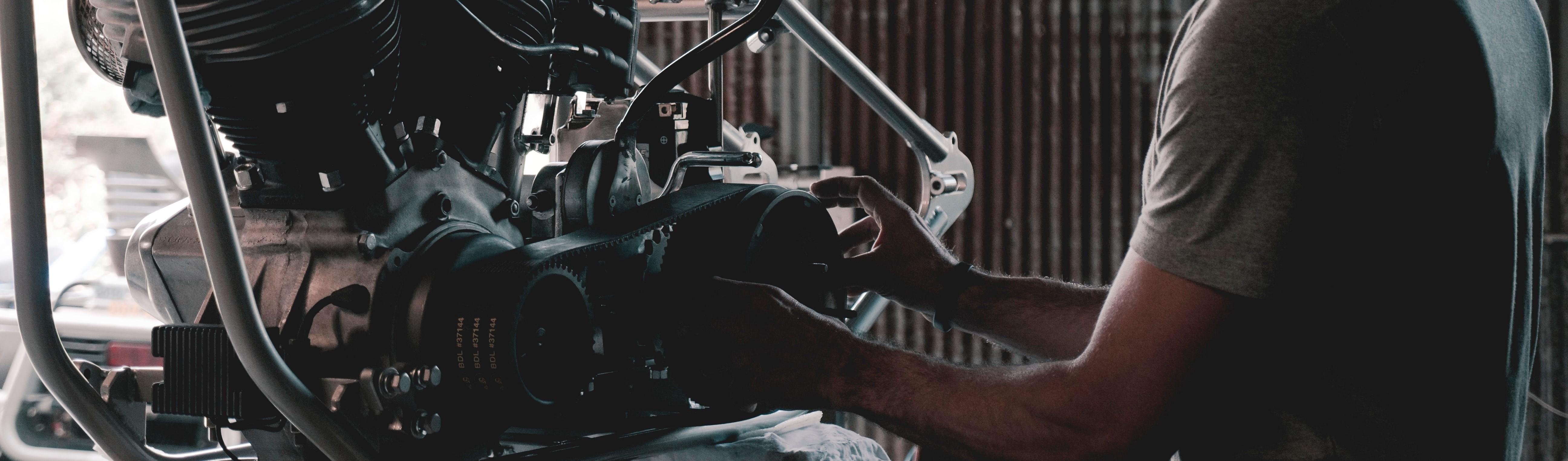 Car Mechanic Checking Transmission - GWCars.org